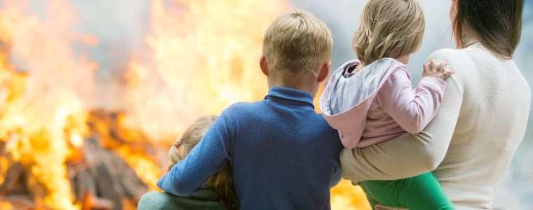 Family watching home burn