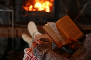 Cozy fire with book